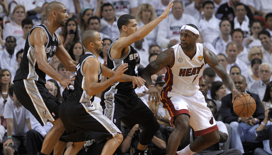 LeBron James (R) of the Miami Heat tries to navigate before the trio of Danny Green (3rd-L), Tony Parker (2nd-L) Tim Duncan (L) of the San Antonio Spurs in the first half during Game 1 of the NBA Finals on June 6, 2013 at American Airlines Arena in Miami, Florida. PHOTO / Brendan SMIALOWSKI - Getty Images