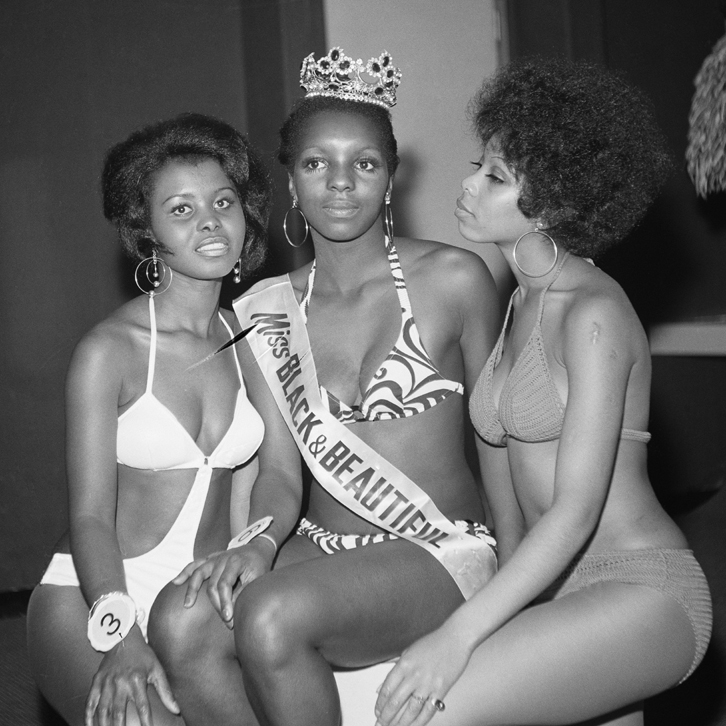 (unidentified) Miss Black & Beautiful with fellow contestants, London, Hammersmith Palais, 1970s.