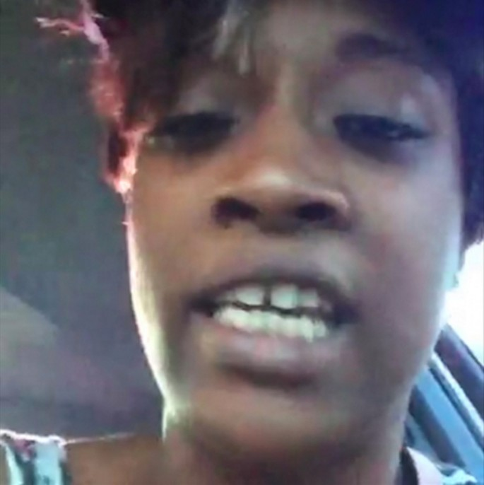 From the front seat of a car, Diamond Reynolds livestreams to Facebook as her partner, Philando Castile, lays dying next to her from a policeman's bullet. Reynolds confronts the police officer as she talks into the camera and recounts the moments earlier when the police officer fired on Mr. Castile. St. Paul, Minnesota, July 2016, courtesy of Diamond Reynolds/Facebook.