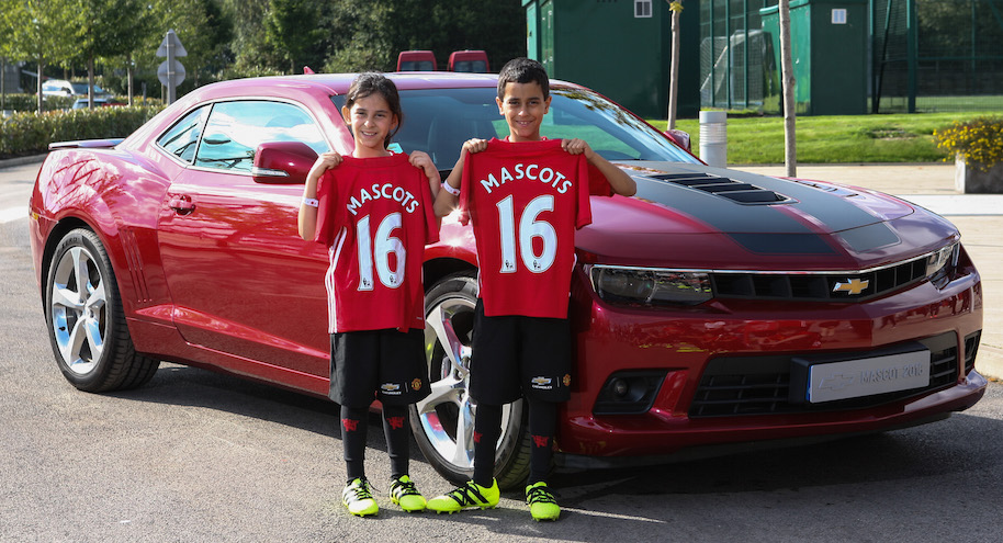 Twins, Qassim and Ruqaya posing with a Chevrolet Camaro outside ATC. Photographs © Copyright by Julian Andrews. Eye R8 22/09/2016. Manchester, England Chevrolet Mascot Moment 2016. Day 3. Chevrolet Mascots 2016 with Camara car at Carrington.