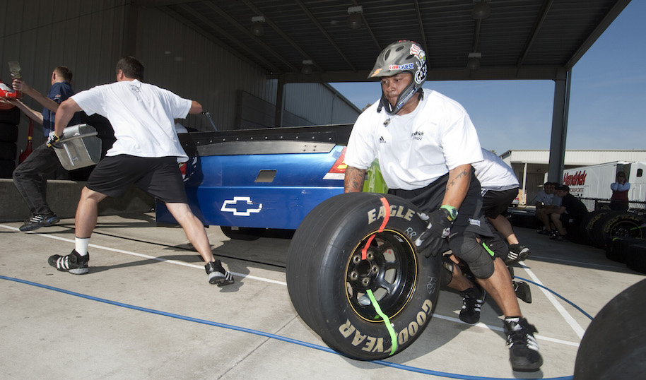 """Dion """"Rocko"""" Williams, the rear-tire carrier for Hendrick Motorsports, is one of just a handful of African Americans working today in NASCAR's pit crews. (Jeff Willhelm/Charlotte Observer/MCT)"""