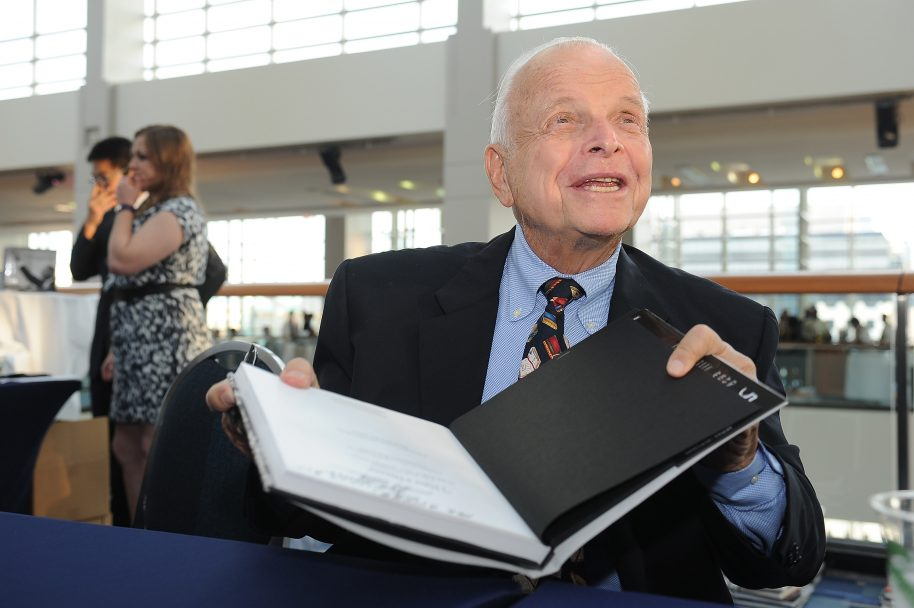 WASHINGTON, DC - AUGUST 22: Bob Adelman signs a copy of his book at the Emancipation Of Capital Gala And Awards Ceremony celebrating the 150th Anniversary of the Emancipation Proclamation at Washington Convention Center on August 22, 2013 in Washington, DC. (Photo by Larry French/Getty Images)