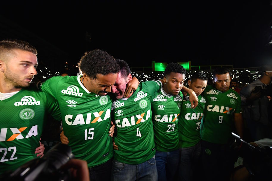 Players of Brazil's Chapecoense football club participate in a tribute to their fellow players killed in a plane crash Monday night in Colombia, at the club's stadium in Chapeco, Santa Catarina, Brazil, on November 30, 2016. (Photo credit should read NELSON ALMEIDA/AFP/Getty Images)