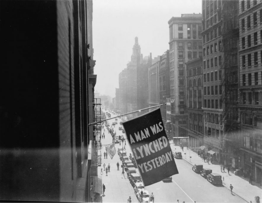 UNKNOWN PHOTOGRAPHER, NEW YORK, NY, 1936. Washington, DC, Library of Congress, Prints and Photographs Division, Visual Materials from the NAACP Records. Flag flying outside the offices of the NAACP on Fifth Avenue, announcing that another lynching had taken place in America.