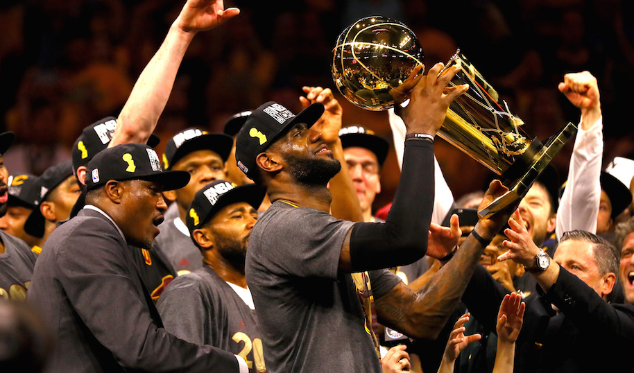 LeBron James #23 of the Cleveland Cavaliers holds the Larry O'Brien Championship Trophy after defeating the Golden State Warriors 93-89 in Game 7 of the 2016 NBA Finals at ORACLE Arena on June 19, 2016 in Oakland, California. (Photo by Ezra Shaw/Getty Images)