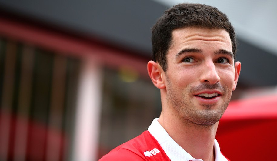 Alexander Rossi of the United States and Manor Marussia walks in the paddock during previews to the Formula One Grand Prix of Singapore at Marina Bay Street Circuit on September 17, 2015 in Singapore. (Photo by Mark Thompson/Getty Images)