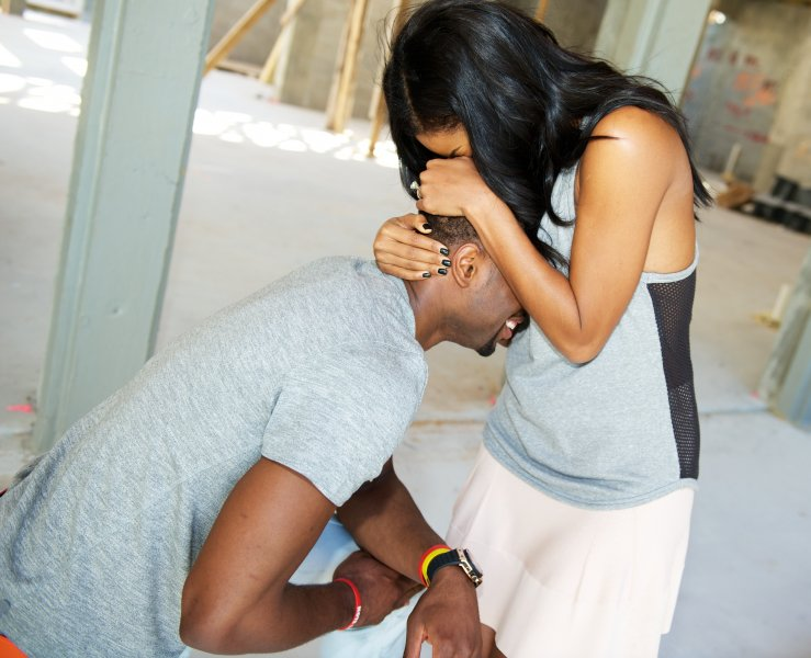 Gabrielle Union embraces her new fiancee Dwyane Wade in the moments after he proposed on December 21, 2013 in Miami