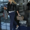 Gwyneth Paltrow pulling her own luggage as she arrives at John F. Kennedy International Airport