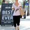 Actress Kaley Cuoco picks up two coffee's at Starbucks