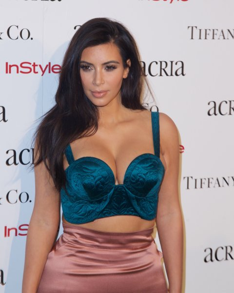 19th annual ACRIA Holiday Dinner in New York CityFeaturing: Kim KardashianWhere: New York City, New York, United StatesWhen: 11 Dec 2014Credit: Alberto Reyes/WENN.com