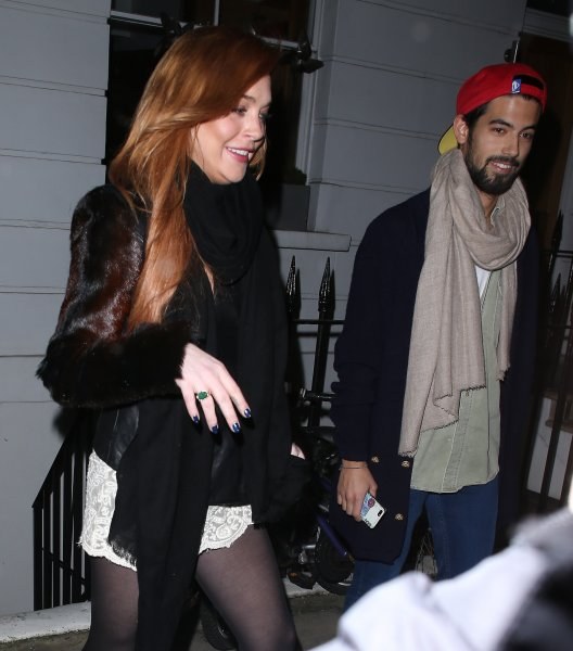 Lindsay Lohan departs a residence in London after calling for a police escort