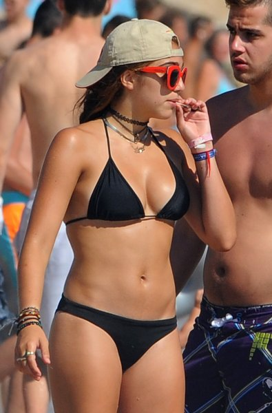 Lourdes Leon, the daughter of Madonna, smoking a suspicious-looking rolled-up cigarette in a bikini, as she enjoys a summer holiday with friends in the south of France Featuring: Lourdes Leon Where: Cannes, France When: 13 Aug 2014 Credit: WENN.com **Not available for publication in Italy**