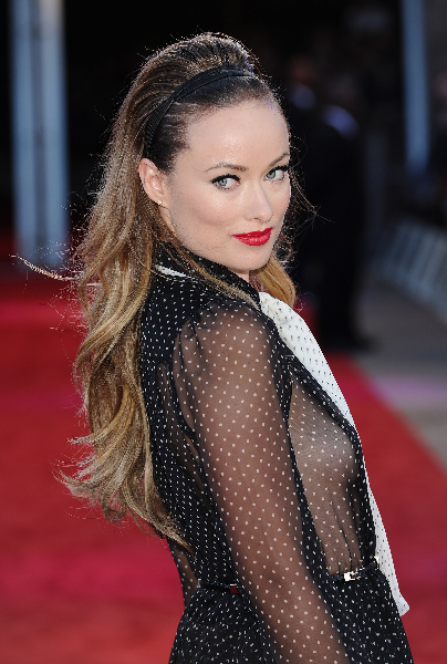Actress Olivia Wilde attends the 'Cowboys and Aliens' UK film premiere