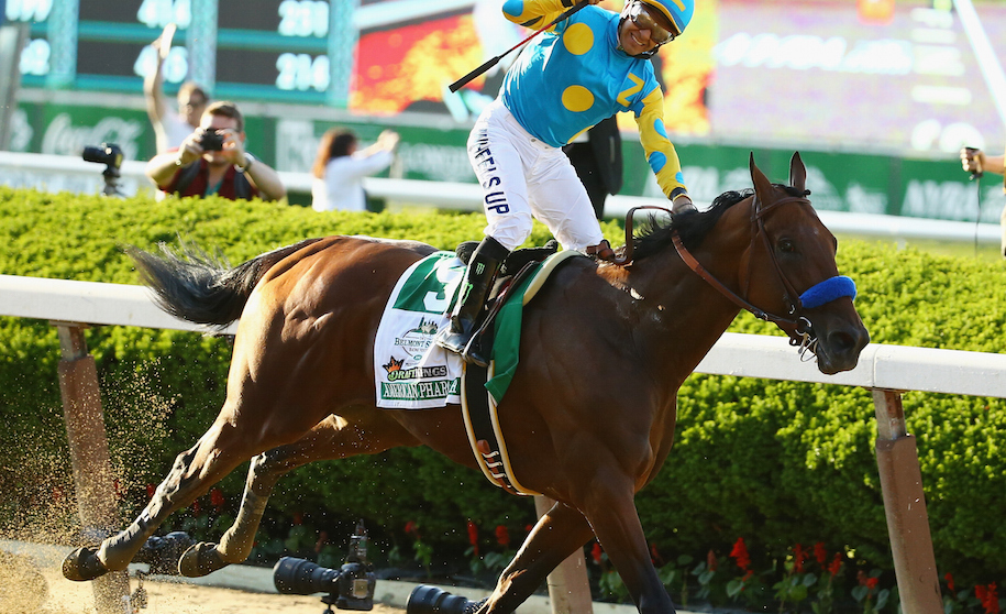 ELMONT, NY - JUNE 06: Victor Espinoza celebrates atop American Pharoah #5 after winning the 147th running of the Belmont Stakes becoming the first horse in 37 years to win the Triple Crown at Belmont Park on June 6, 2015 in Elmont, New York. (Photo by Al Bello/Getty Images)