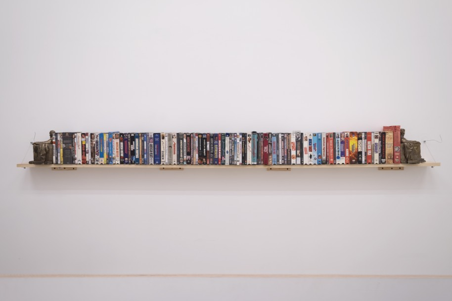 """Eric Yahnker, """"American Piece,"""" 2010-2016). 94 DVD/VHS media, 2 bookends"""