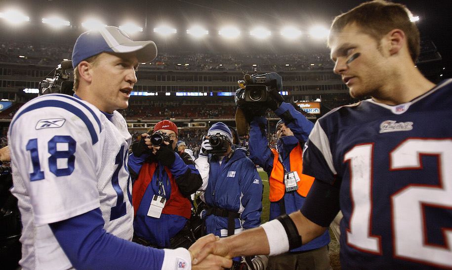 New England Patriots' Tom Brady, right, shakes hands with Indianapolis Colts' Peyton Manning after a game between New England Patriots and Indianapolis Colts at Gillette Stadium, Foxborough, Massachusetts, Sunday, November 5, 2006. Colts won 27-20. (Photo by Jim Rogash/Getty Images)
