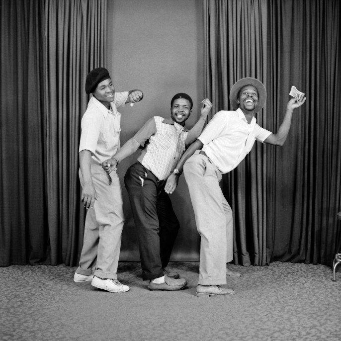 S. J. Moodley, [Three men dancing in a line], 1975