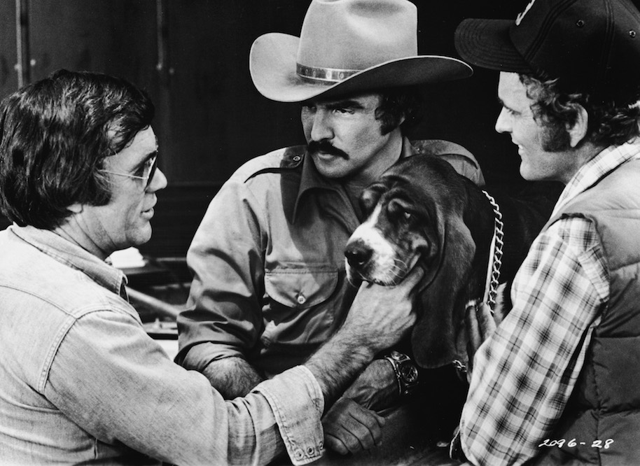 American director Hal Needham lines up a shot with actors Burt Reynolds and Jerry Reed and Happy on the set of the movie 'Smokey and the Bandit,' 1977. (Photo by Universal Studio/Getty Images)