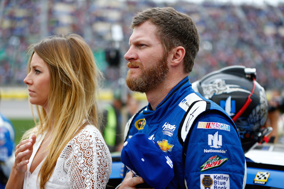 Earnhardt Jr. with his wife Amy Reimann during the national anthem ahead of the NASCAR Sprint Cup Series SpongeBob SquarePants 400 at Kansas Speedway. (Photo by Jonathan Ferrey/Getty Images)
