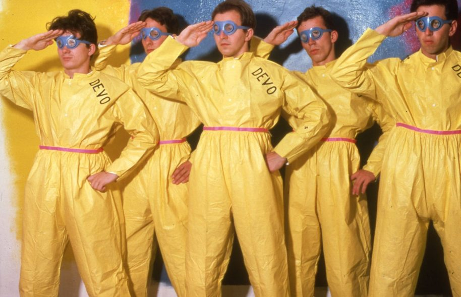 This iconic image from 1978, the breakthrough year for the band, features DEVO in their signature hazmat suits. Courtesy DEVO-Obsesso Archives Photograph by Eric Blum