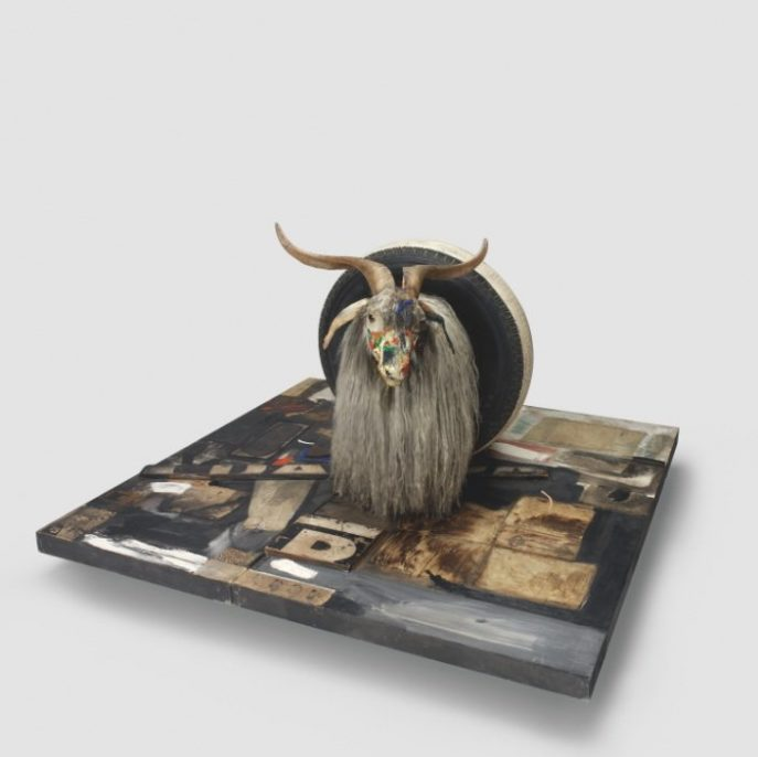 Robert Rauschenberg. Monogram. 1955–59. Oil, paper, fabric, printed reproductions, metal, wood, rubber shoe-heel, and tennis ball on two conjoined canvases with oil on taxidermied Angora goat with brass plaque and rubber tire on wood platform mounted on four casters, 42 × 53 1/4 × 64 1/2 in. (106.7 × 135.2 × 163.8 cm). Moderna Museet, Stockholm. Purchase with contribution from Moderna Museets Vänner/The Friends of Moderna Museet. © 2017 Robert Rauschenberg Foundation