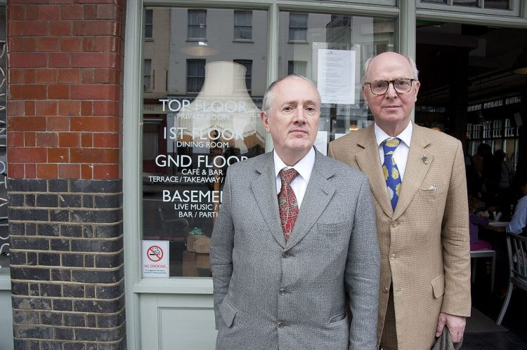 Gilbert & George, 2010. © Bryan Ledgard, courtesy of Wikimedia Commons.