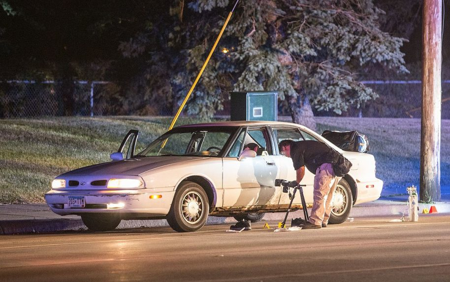 Minnesota Bureau of Criminal Apprehension (BCA) investigators process the scene of where a St. Anthony Police officer shot and killed 32-year-old Philando Castile in a car near Larpenteur Avenue and Fry Street in Falcon Heights, Minnesota, on July 6, 2016.. Photo: Tony webster/Wikimedia Commons