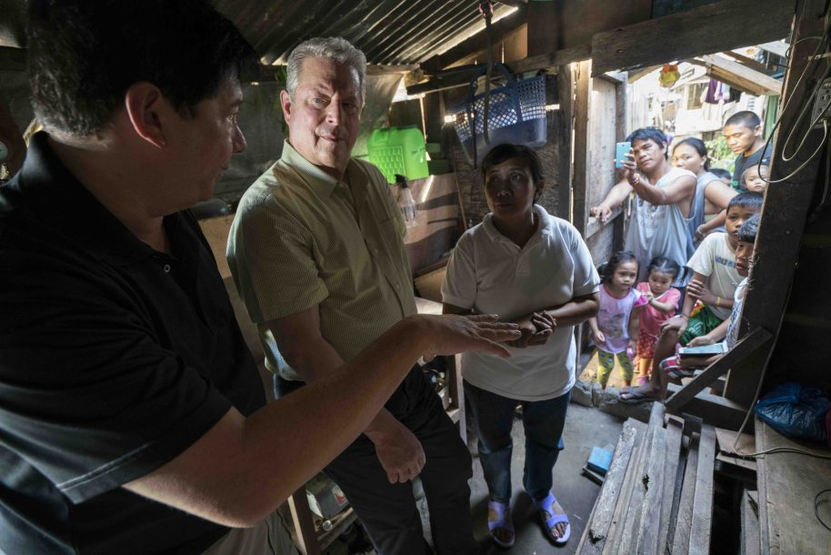 VP Al Gore with former Mayor of Tacloban City Alfred Romualdez and Typhoon Haiyan survivor Demi Raya, in the Raya family home; Tacloban City, Philippines, March 12, 2016
