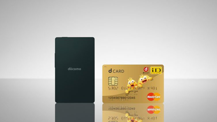 Kyocera smartphone next to a credit card
