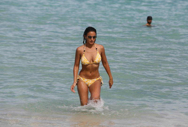 Emmanuelle Chriqui rocked a yellow string bikini as she and boyfriend Adrian Bellani hit the beach in Miami Featuring: Emmanuelle Chriqui Where: Miami Beach, Florida, United States When: 29 Aug 2013 Credit: KEYPIXX/WENN.com **Only available for publication in USA**